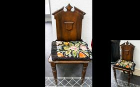 Antique Hall Chair Of small proportions with high back and broken pediment design with carved
