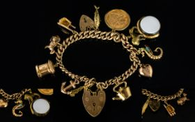 9ct Gold Curb Bracelet Loaded with 10 x 9ct Gold Charms - One 22ct Gold Half Sovereign - Dated 1914
