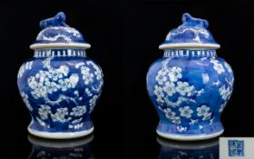 A Pair Of Chinese Ginger Jars And Covers Blue and white with prunus design throughout.
