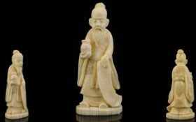 A Small Carved Ivory Okimono Figure In the Form Of A sage with pot and scroll.