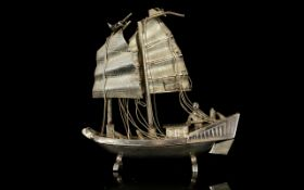 A Miniature Silver Sailing Ship Figure Small and detailed silver model in the form of a twin sail