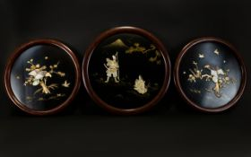 A Set Of Three Japanese Inlaid Panels Circular wall mounted panels, two depicting birds of prey on