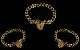 9ct Gold Curb Bracelet with 9ct Gold Heart Shaped Padlock and Safety Chain,