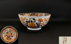A Large Oriental Punch Bowl With Imari decoration to interior and exterior,