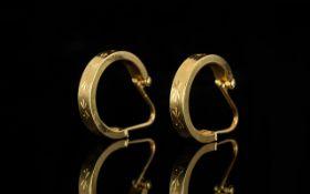 18ct Gold Pair of Hoop Earrings, Patterned 3/4 hoop earrings with hinged wire stem. Hallmarked 750.