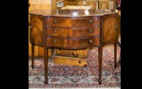 A Mid 20th Century Reproduction Serpentine Fronted Mahogany Sideboard - shaped front,