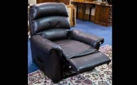 A Contemporary Leather Reclining Chair Plush chair upholstered in black pebbled leather with massage