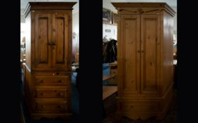 Two Pine Wardrobes each single wardrobes, the first raised on base with x3 drawers.