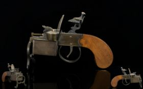 A Dunhill Tinder Pistol Design Table Lighter length 14.5cm.