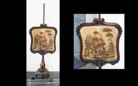 Antique Mahogany Embroidered Panel Pole Screen raised on trefoil feet with ornate carved column, the
