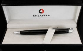 Sheaffer Chrome Plate Trim Ball Point Pencil complete with black case. As new condition.