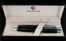 Sheaffer Chrome Plate Trim Ball Point Pen/Pencil Set complete with black case. As new condition.