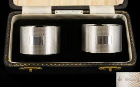 A Boxed Pair of Fine Quality Silver Napkin Holders, Engine Turned with Vacant Cartouches.