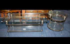 Two Contemporary Glass And Brass Tables Mirrored brass and bevelled glass table,