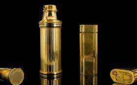 Cartier Paris Gold Plated Lighter Slimline lighter, ribbed form, serial number E61363.