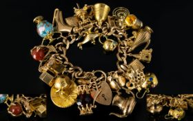 Superb Quality 9ct Gold Curb Bracelet Loaded with 28 9ct Gold Charms.
