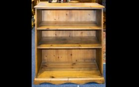 Two Pine Bookshelves comprising tall unit with x2 fixed shelves and cupboard base.