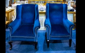 A Pair of Wing Back Armchairs - of typical form.