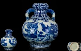 A 20th Century Blue And White Twin Handle Onion Topped Vase Blue and white decoration depicting