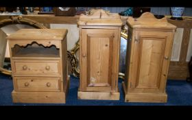 A Pair Of Pine Bedside Cabinets with single cupboard and plinth bases.
