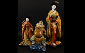 A Pair of Mid 20th Century Japanese Deity Doll Figures Each on wood stands,