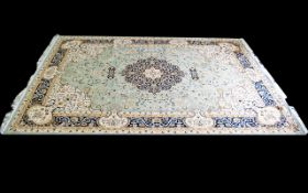 A Very Large Woven Silk Carpet Keshan rug with Eau De Nil ground and traditional Middle Eastern