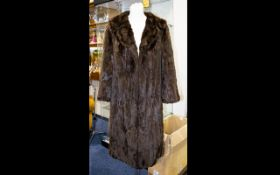 Mink Coat Dark Brown from Fletcher of Southport. Fully lined in brown polysilk fabric.