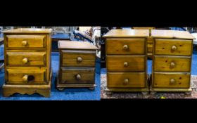 A Pair Of Pine Bedside Cabinets comprising x3 drawers with bun feet.