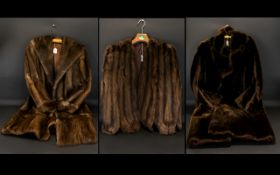 A Collection of Three Fur Coats, to include: Golden Brown Mink Evening Cape, fully lined.