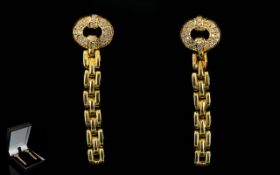 A Pair Of 18ct Gold And Diamond Set Drop Earrings Of stylised form with post and stud fastening.