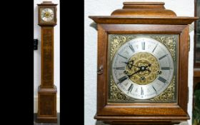 A Westminster Chime Granddaughter Clock Of typical form with ribbon inlay banding to case and brass