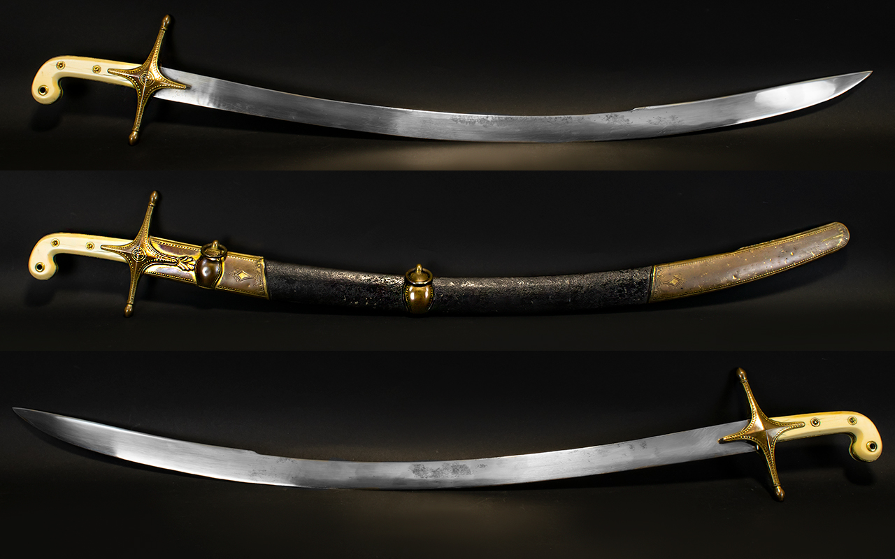Lot 1300 - A Rare And Impressive 11th Dragoons Officers Mameluke Sword And Dress Scabbard The curved, flat,