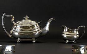 George III - Silver Teapot with Matched Milk Jug of Superb Shape and Design, Raised on Ball Feet.