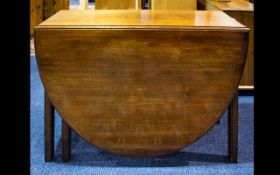A Large 19th Century Drop Leaf Dining Table - with gate leg supports.