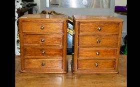 A Pair Of Miniature Chests Of Drawers In beech wood, each with four drawers,