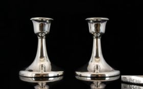 Art Deco Period Pair of Small Candlesticks of Plain Form and Good Lines and Splayed Circular Bases.