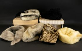 A Collection Of Vintage Fur Hats In two original hat boxes,