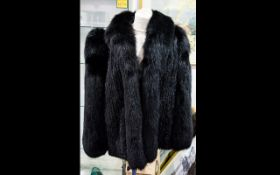 Black Fox Fur Jacket. Hip length style. Fully lined in black polysilk fabric. Size 12.