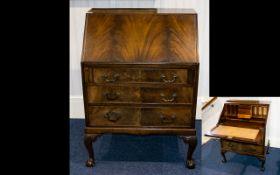 A Queen Anne Style Bureau Fall front bureau above three graduated drawers. Short cabriole legs