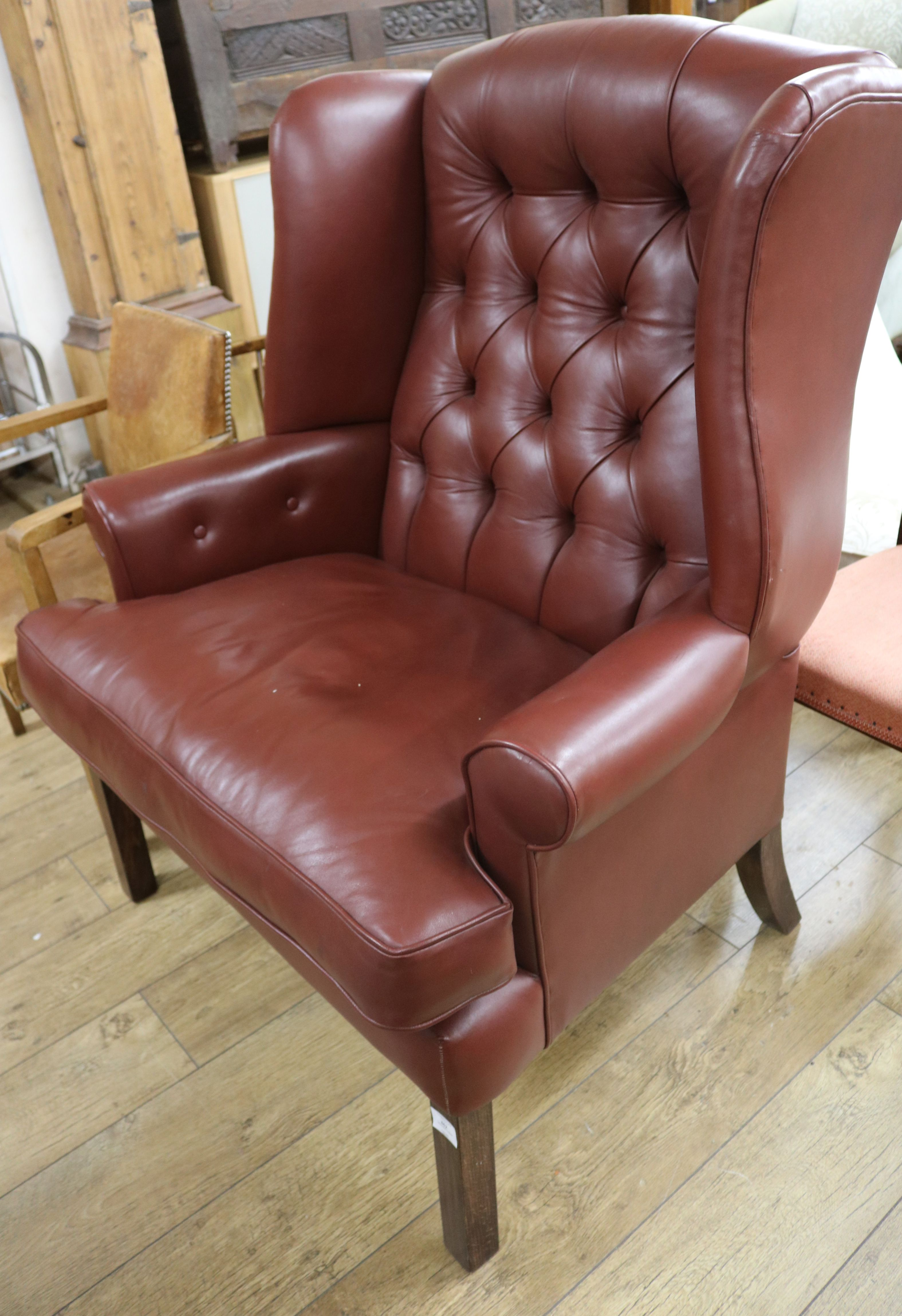 Lot 862   A Button Back Leather Wing Armchair
