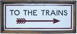 London Underground enamel sign in original Oak frame TO THE TRAINS, with Right pointing feathered