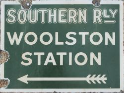 Southern Railway enamel sign WOOLSTON STATION with feathered arrow beneath. Double sided, both sides