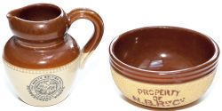 A pair of North British Railway salt glazed earthenware items consisting of a small finger bowl face