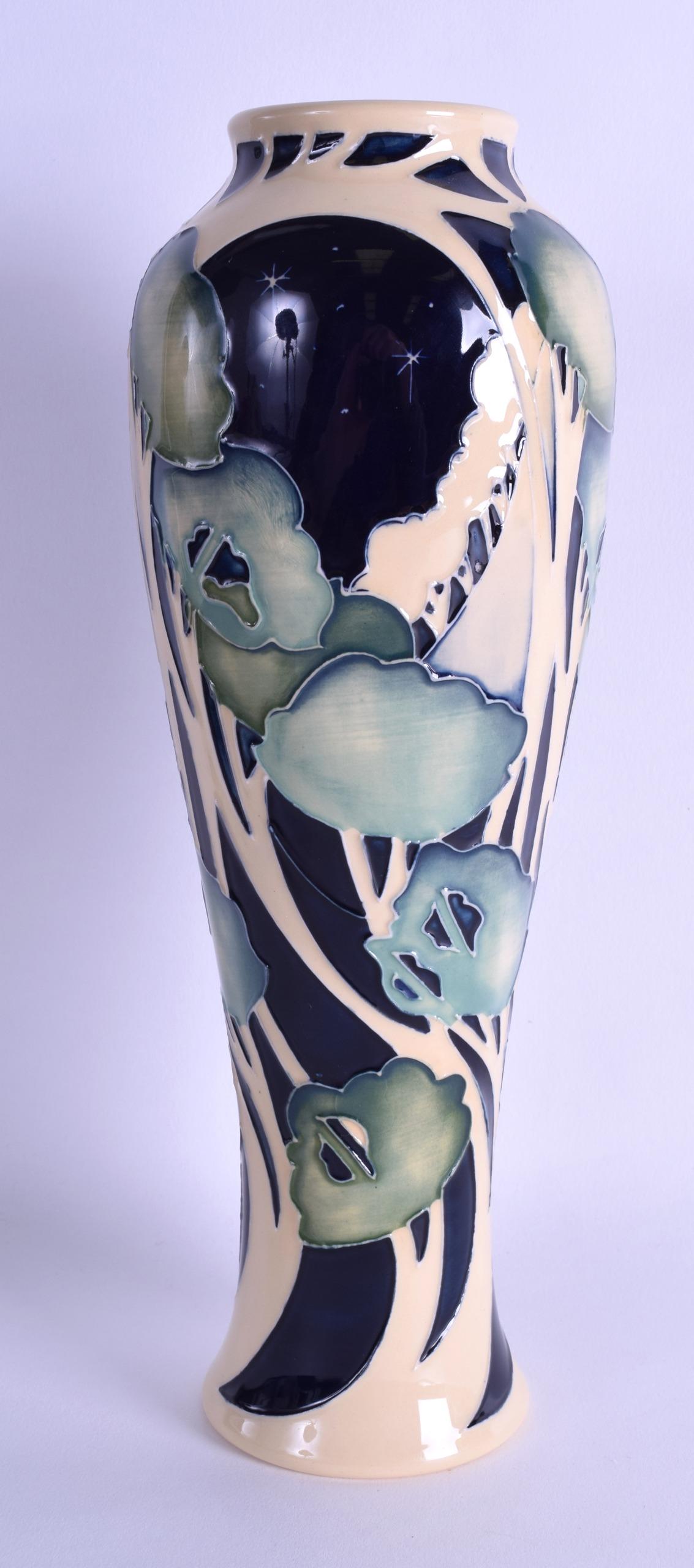 Lot 46 - A MOORCROFT 'TREES IN MOONLIGHT' VASE designed by Vicky Lovatt. No 76 of 150. 26.5 cm high.
