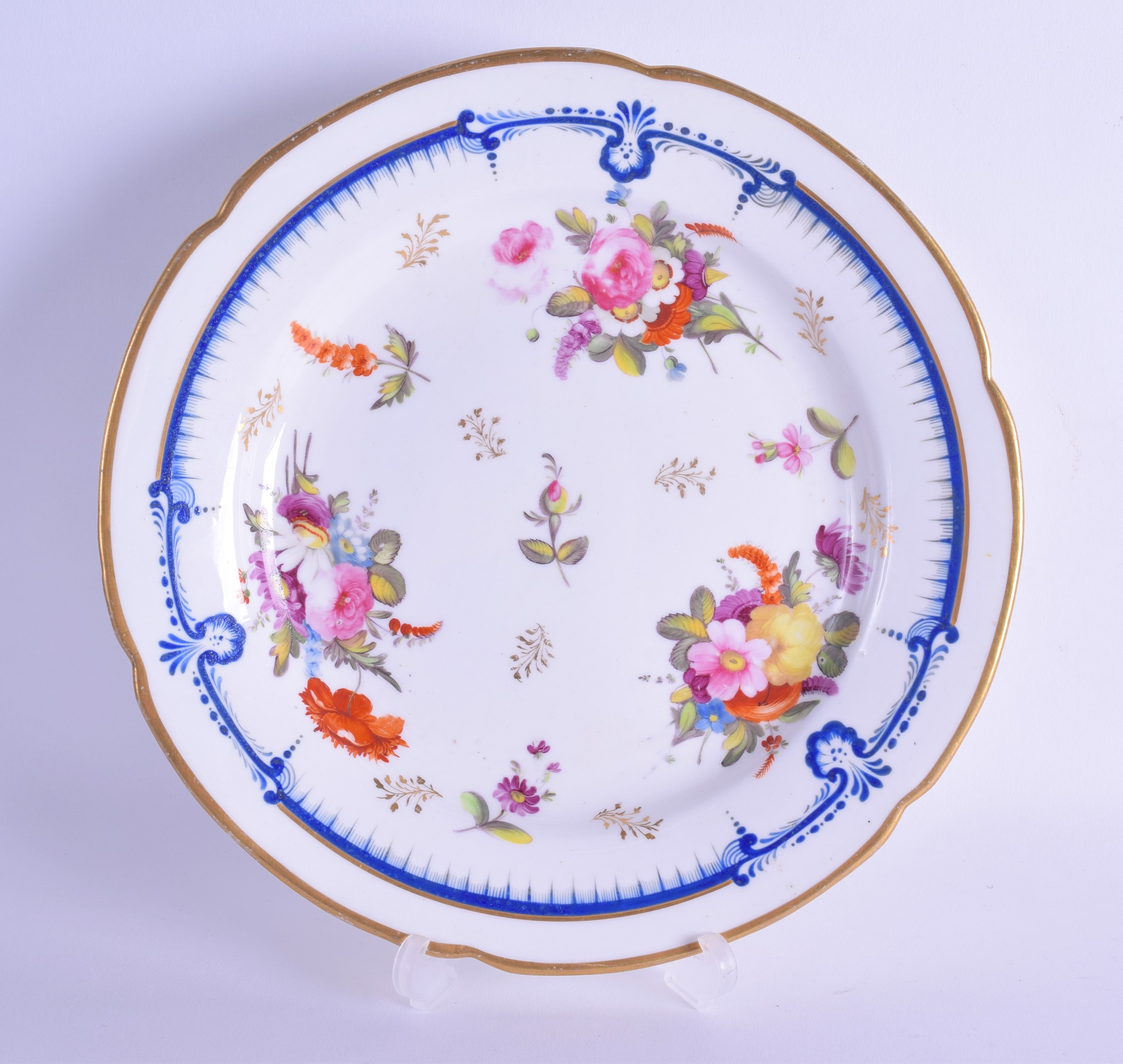 Lot 125 - Early 19th c. Coalport plate painted in Derby style with scattered floral sprays under a dry blue