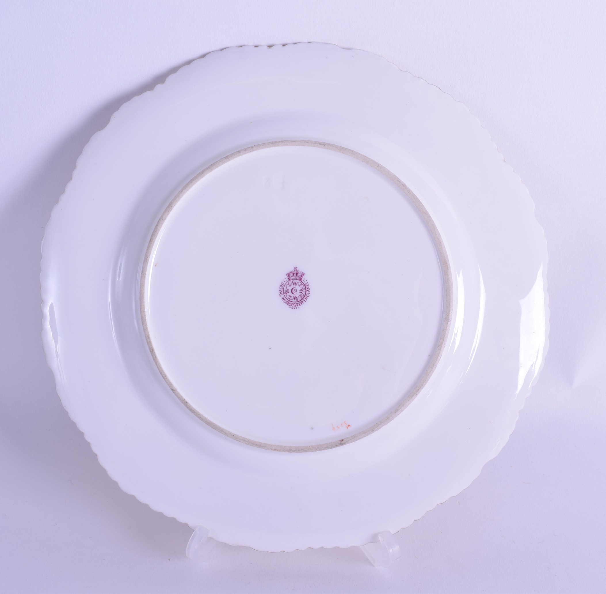 Lot 157 - Royal Worcester plate painted with wild flowers to the centre and in gilt panel cartouches
