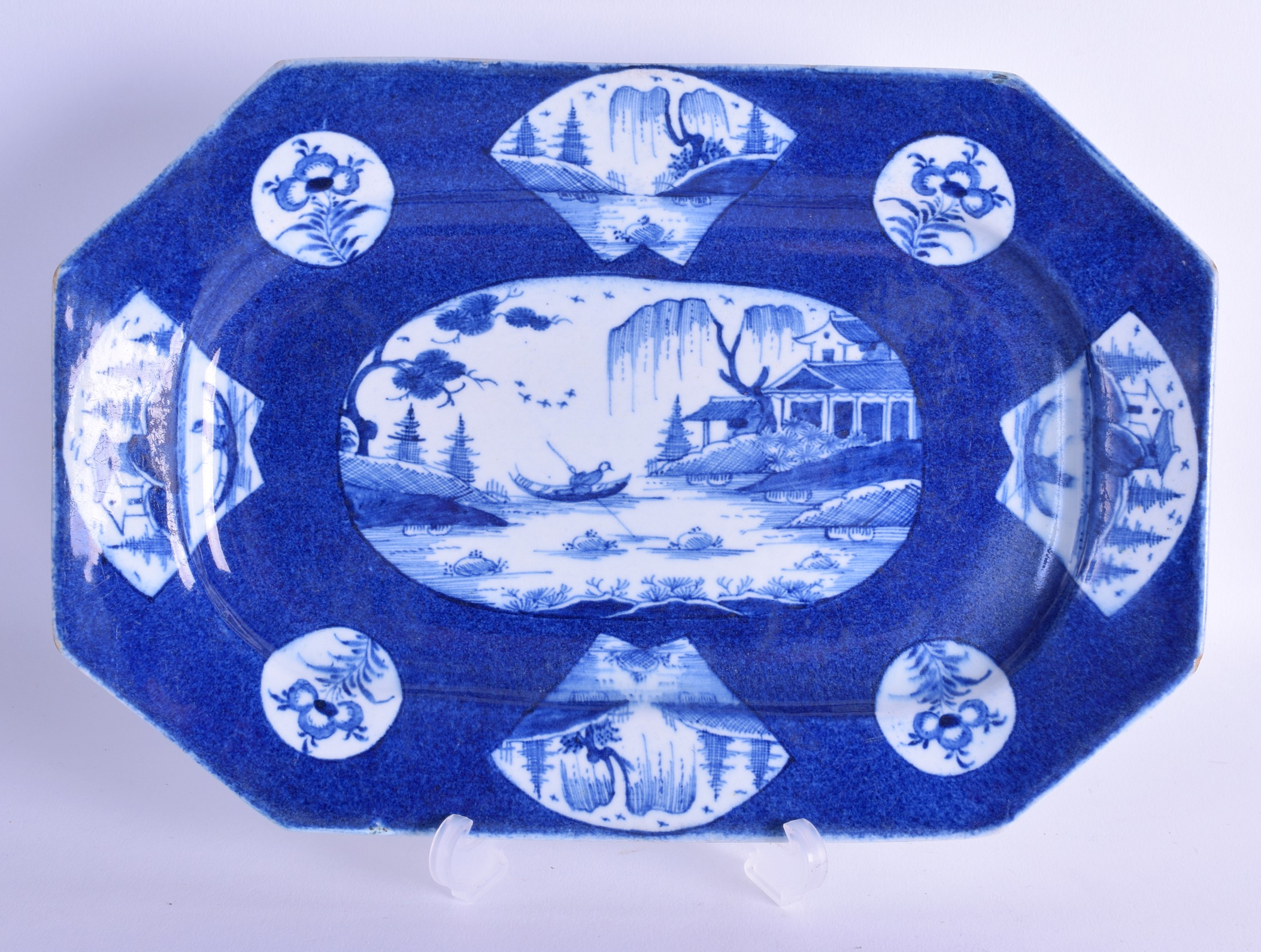 Lot 140 - 18th c. Bow octagonal platter painted with a central landscape and four panel landscapes and three