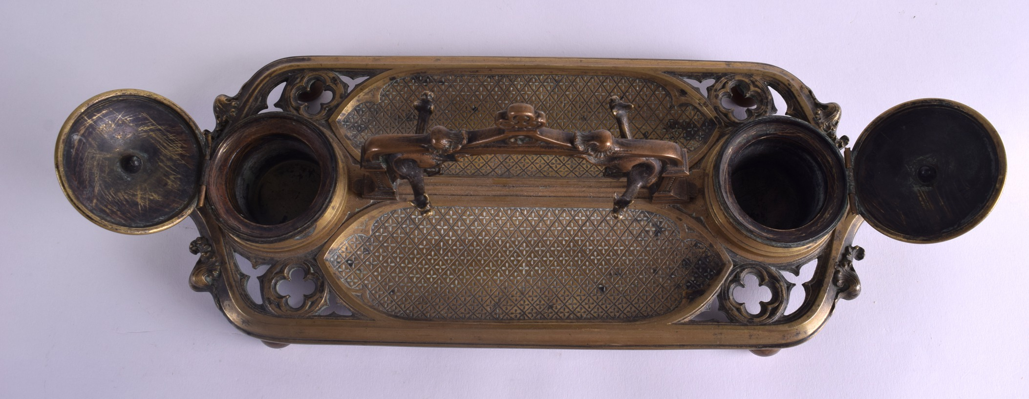 Lot 489 - A 19TH CENTURY FRENCH GOTHIC REVIVAL BRONZE DOUBLE INKWELL of rectangular form with open work