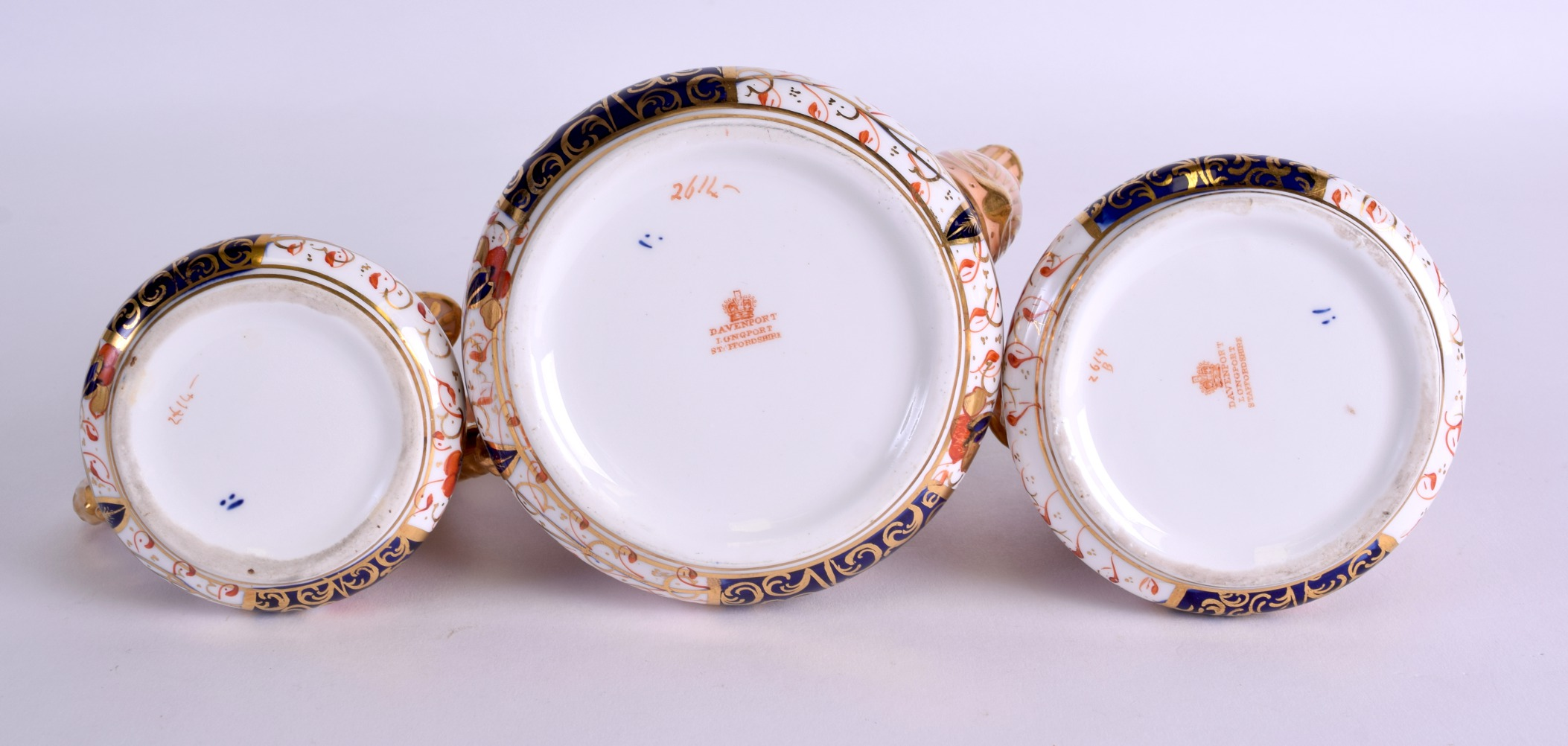 Lot 80 - A 19TH CENTURY DAVENPORT IMARI THREE PIECE TEASET painted with flowers. Teapot 16 cm wide. (3)