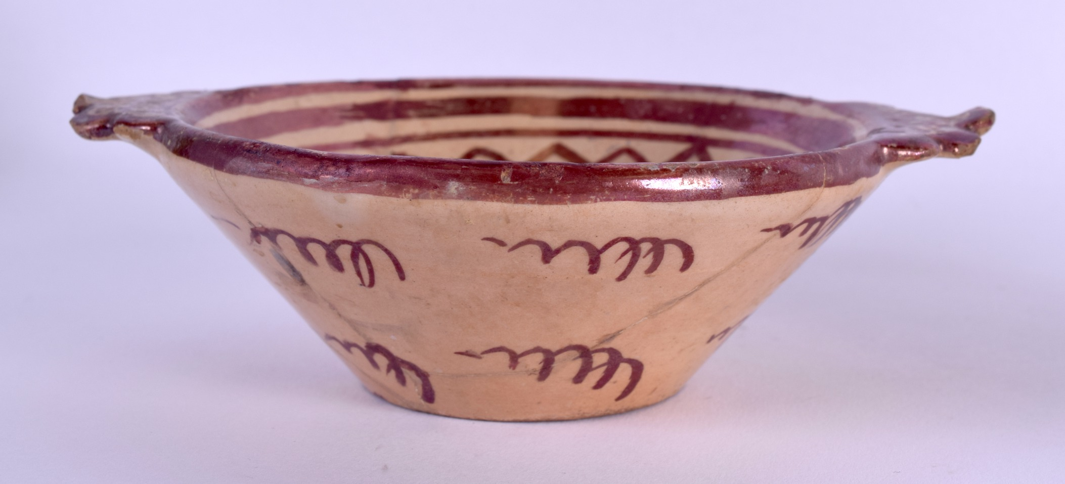 Lot 64 - AN EARLY HISPANO MORESQUE TIN GLAZED BOWL together with a matching saucer. 14 cm & 12 cm wide. (2)